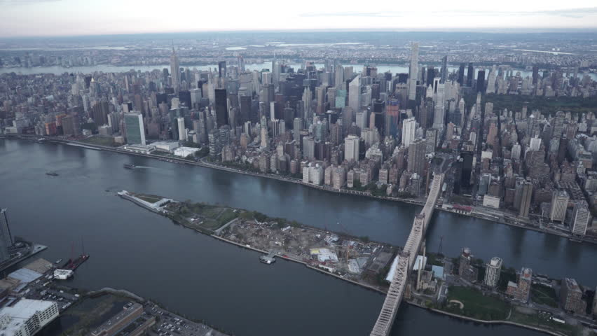 New York City Circa-2015, wide angle aerial view of Midtown Manhattan skyline, Central Park, the East River and the Queensboro Bridge, from Long Island City