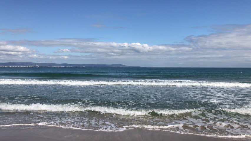 Beach and sea in bright sunlight | Shutterstock HD Video #1017560092