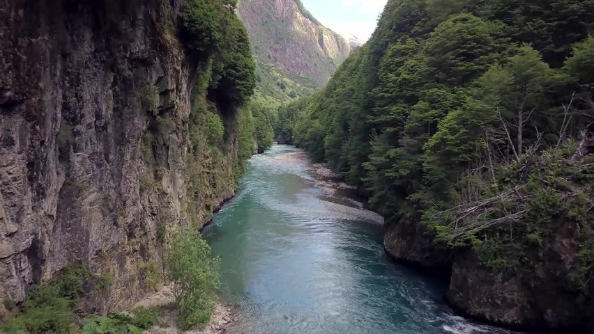 Aerial Drone footage of Fly Fishing in Patagonia in Chile South America the best Outdoor Wilderness River Waterfall rapids fishing valley summer travel adventure tourism