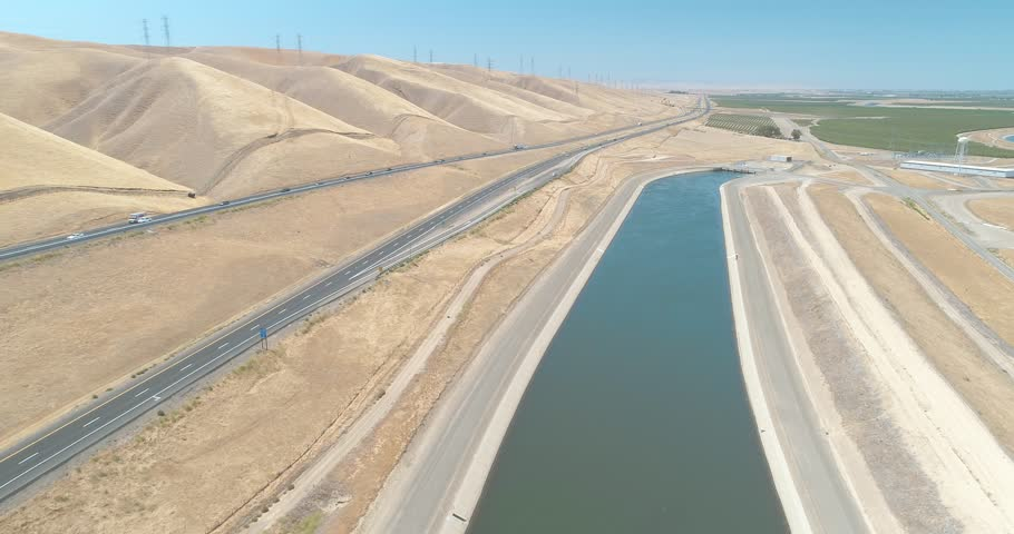 The California Aqueduct Canal running through the central valley of California. Part of the Central Valley Project. USA.