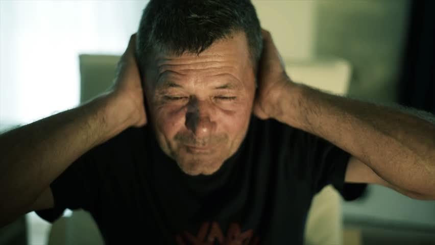 Man with headache, ear pain