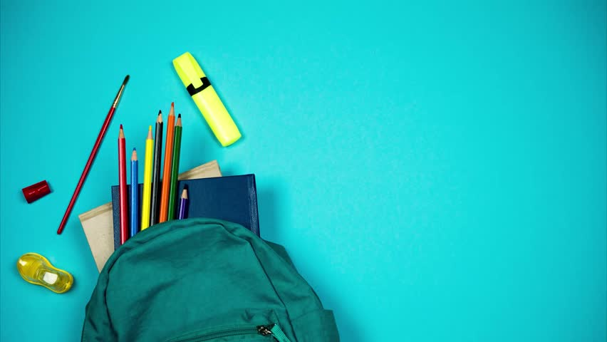 Colorful school supplies moving from school bag on blue background. Back to school concept. Stop motion
