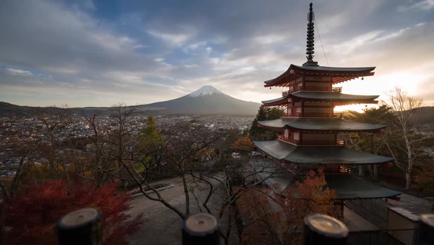 Japan's nature from the altitude. Tall trees grow. Dense, white clouds float in the sky. There is a tall mountain Fudziyama | Shutterstock HD Video #1017620458