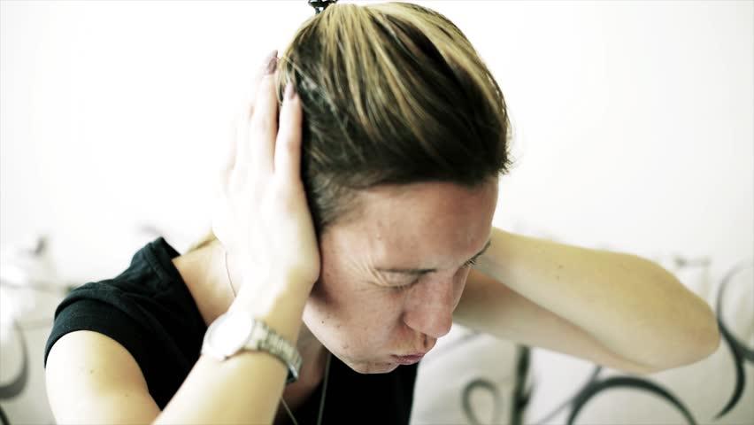 Woman holding her ears. Ear pain and headache unbearable. | Shutterstock HD Video #1017621724