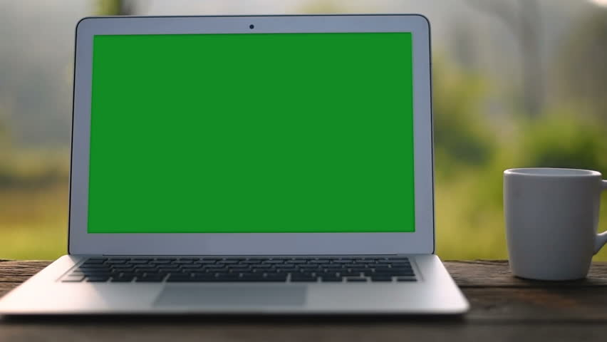 A laptop computer with a key green screen set on work office table. | Shutterstock HD Video #1017626905