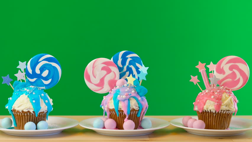 Pink and blue theme colorful novelty cupcakes decorated with candy and large lollipop for children's, teen's birthday, Valentine's or party celebrations, on removable chroma key background.. | Shutterstock HD Video #1017633940