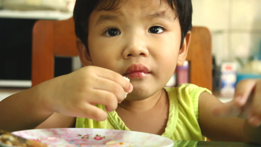 Thai child eating food on the table | Shutterstock HD Video #1017689287