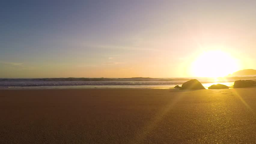 Time-lapse footage of a sunset at the ocean beach in Portugal. | Shutterstock HD Video #1017697741
