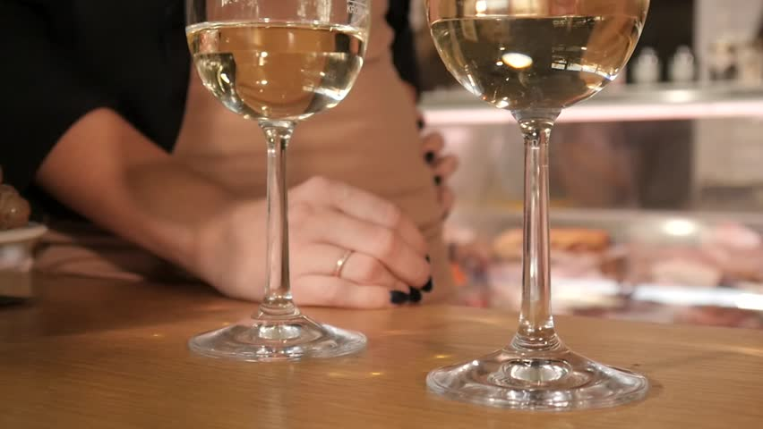 WROCLAW, POLAND - OCTOBER 06, 2018: Two Glasses of white Wine on a Table | Shutterstock HD Video #1017706087