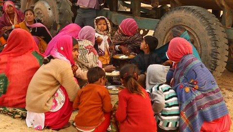 village poor people eating in Desert Rajasthan India 17th Jan 2018