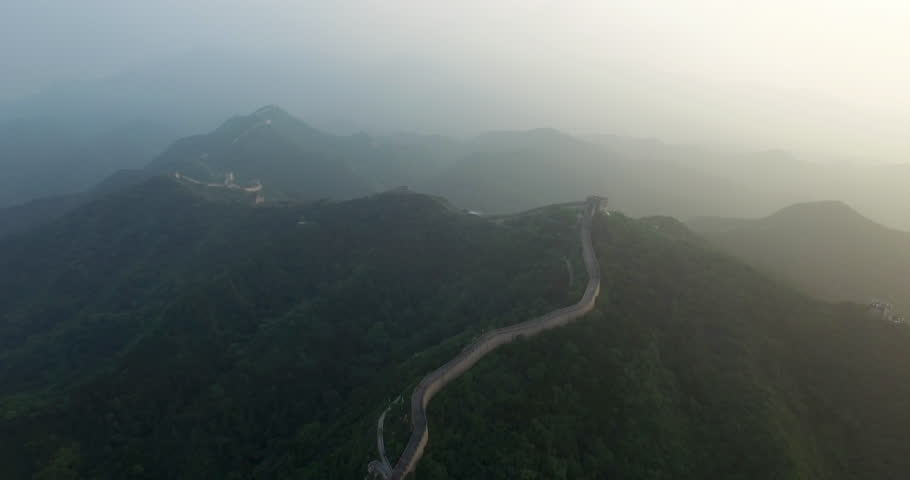 Flying over the China great wall at sunset. Aerial view of China great wall at sunset. Amazing aerial view of China great wall.