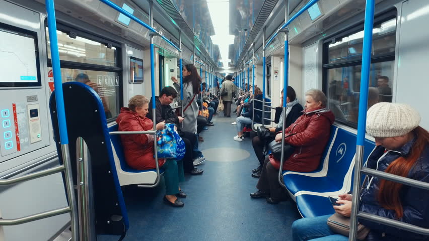 """Moscow, Russia-October 11, 2018: interior of the Moscow metro train """"Moscow"""". Passengers enter the car and sit on the seats"""