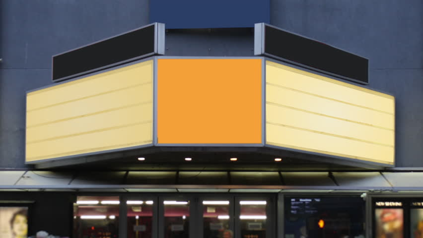 A daytime view of a theater's blank marquee in a large city as pedestrians and traffic pass by.   | Shutterstock HD Video #1017791080