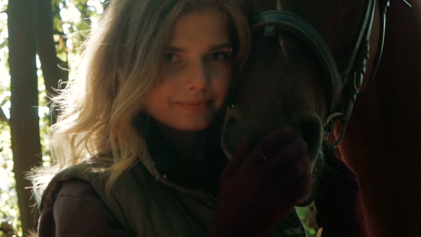 Beautiful girl and a horse   Shutterstock HD Video #1017798460