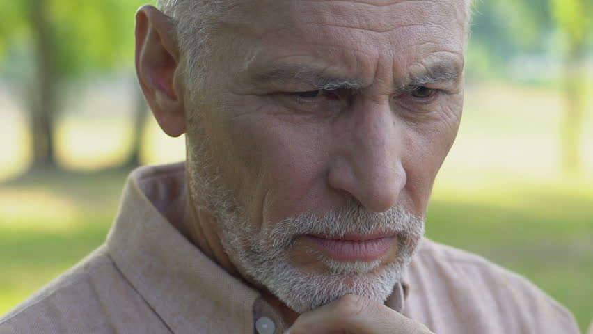 Lonely old man sitting in park and bitterly crying, closing face with hands #1017801178