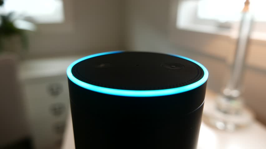Los Angeles, CA, USA - 03/02/18: Amazon Alexa (Echo) lights up as it is voice-activated in a bedroom (darker background).  For editorial use.