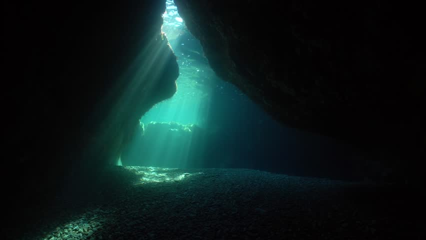 Natural sunlight at the exit of a shallow cave underwater in the Mediterranean sea, Pyrenees-Orientales, Roussillon, France