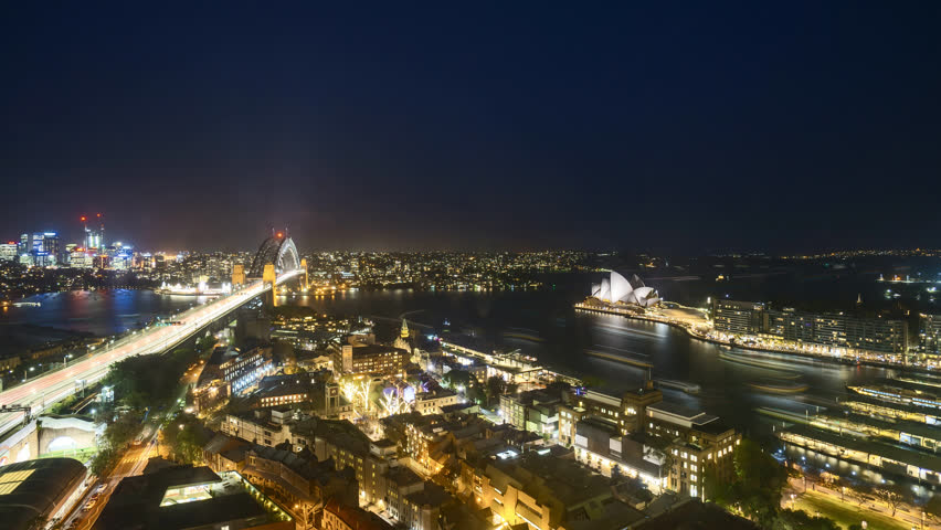 4k UHD time lapse of night scene at Sydney city skyline, aerial view. Tilt down | Shutterstock HD Video #1017828340
