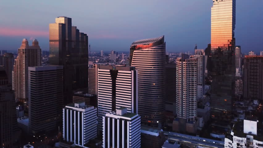 Aerial view of Chong Nonsi, Sathorn, Bangkok Downtown. Financial district and business centers in smart urban city in Asia. Skyscraper and high-rise buildings at sunset.