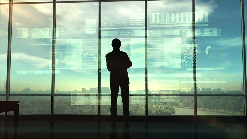 Silhouette of a trader in the office before infographics   Shutterstock HD Video #1017857938