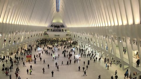 NEW YORK, USA - OCTOBER 13, 2018: People moving across inside of the Oculus, New York's modern train station