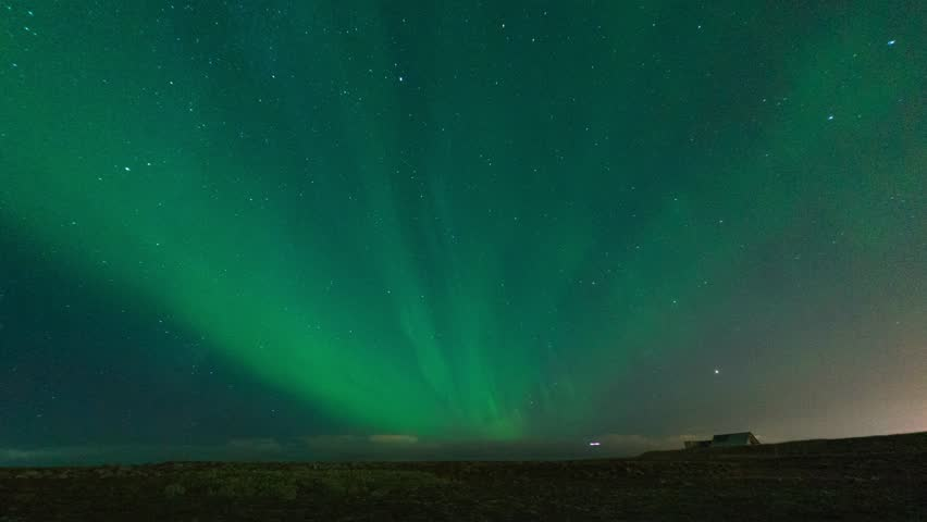 Timelapse of Aurora Borealis or Northern Lights in near Keflavik Airport, Iceland. 4K UHD.