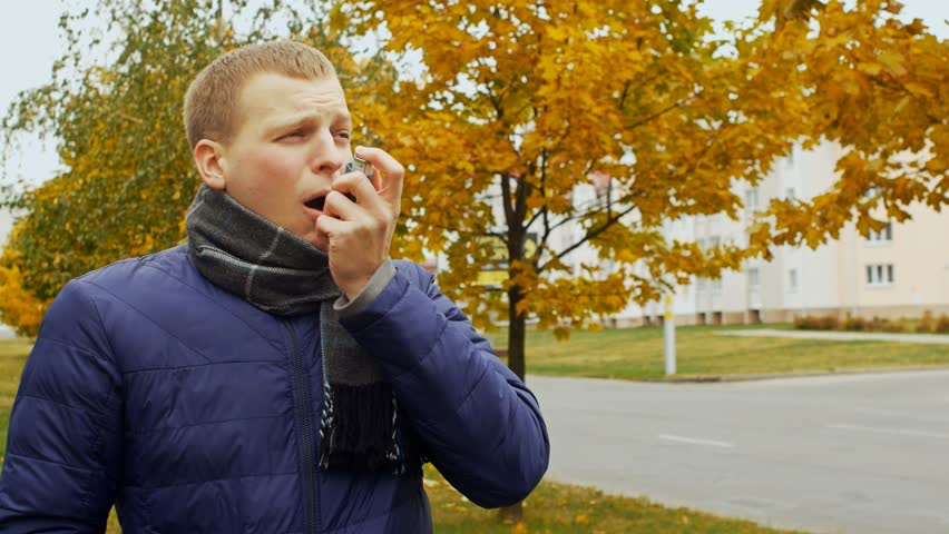 asthmatic gasps and uses the medicinal inhaler spray aerosol, asthma attack Royalty-Free Stock Footage #1017902116