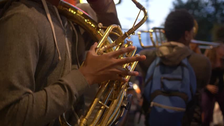 New Orleans, Louisiana / USA - May 14th 2018: Street Musician Playing Tuba, Tourists Dancing