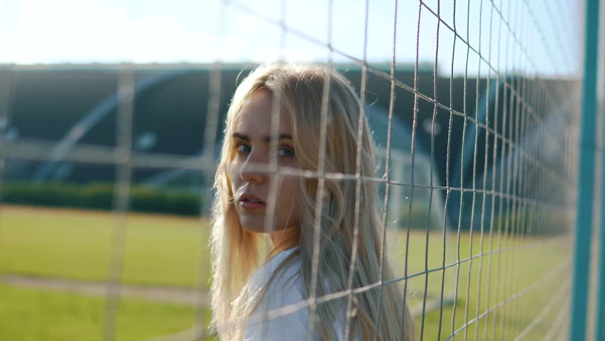 Baby Blonde Girl Near Soccer Net