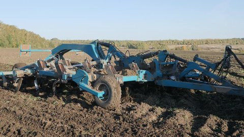 Cultivation of the soil with a tractor. Loosening the soil. Oxygen enrichment. Fighting weeds.