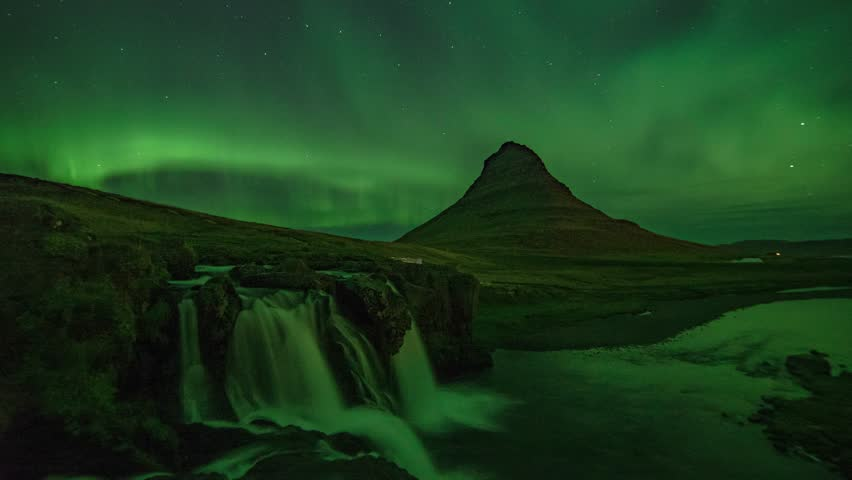 Scenic Time Lapse view of Aurora Borealis (Northern Lights) at Kirkjufell, a famous location in Iceland