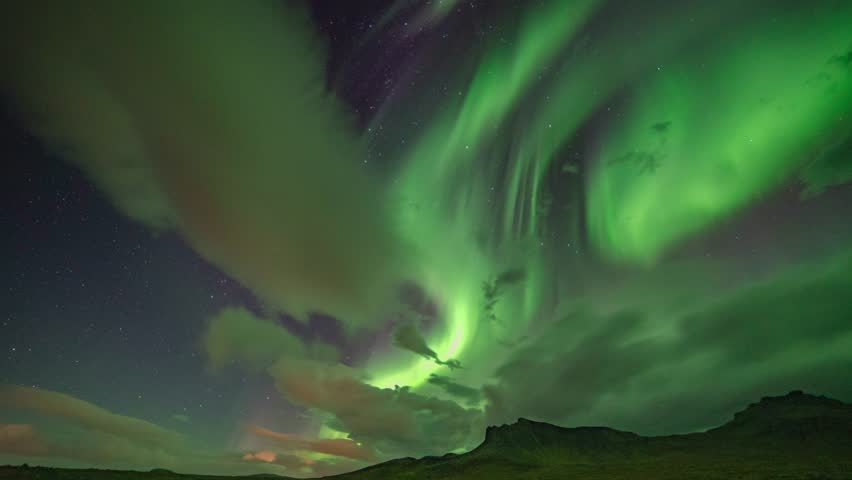 Time Lapse of Scenic view of Aurora Borealis (Northern Lights) in North Iceland. 4K UHD