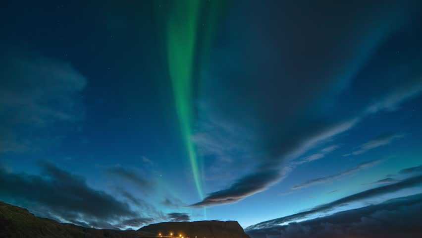 Time Lapse of Aurora Borealis during dusk or blue hour in Iceland. 4K UHD