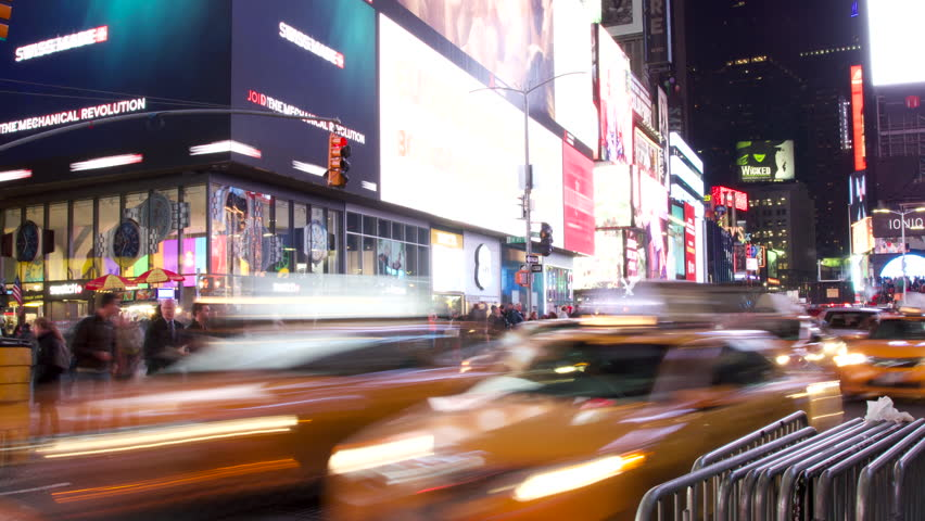 New York, NY / United States - 02 14 2016: New York, NY - February 2016 - Advertisements Flash and Cars Fly By in this Time Lapse of Times Square on a Busy Night | Shutterstock HD Video #1017929056