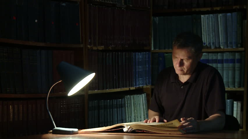 The historian studies old books and documents. Finding the right information Royalty-Free Stock Footage #1017931546