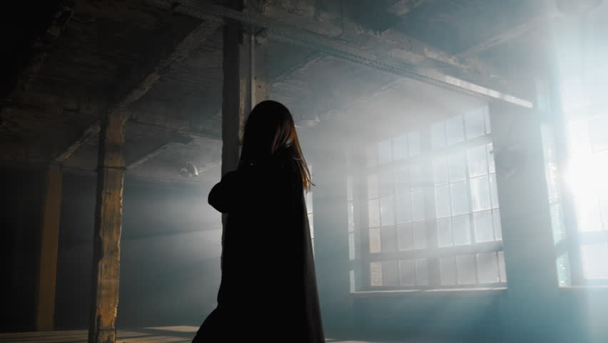 Slow motion dancing girl, dancer performance contemporary modern dance in industrial art space with smog and strong backlight from large windows   Shutterstock HD Video #1017951376