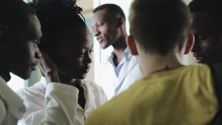 KENYA, KISUMU - MAY 20, 2017: Young beautiful people, women and man in white gown in African hospital.