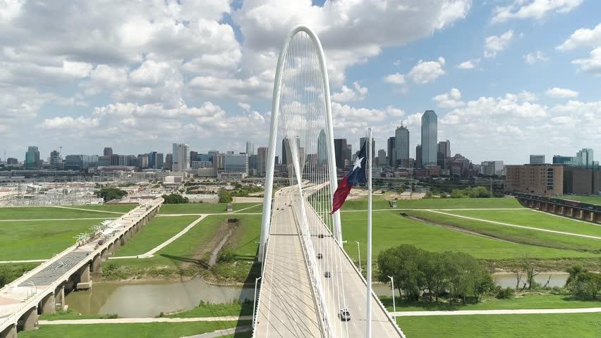 Texas Flag Blows in Breeze Dallas Skyline Margaret Hunt Hill Bridge