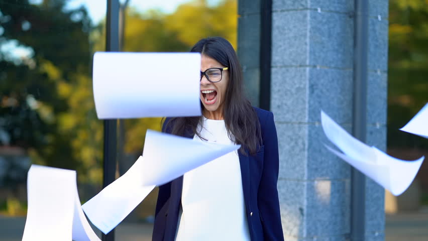 Angry furious female office worker throwing crumpled paper, having nervous breakdown at work, screaming in anger, stress management, mental distress problems, losing temper, reaction on failure Royalty-Free Stock Footage #1017976234