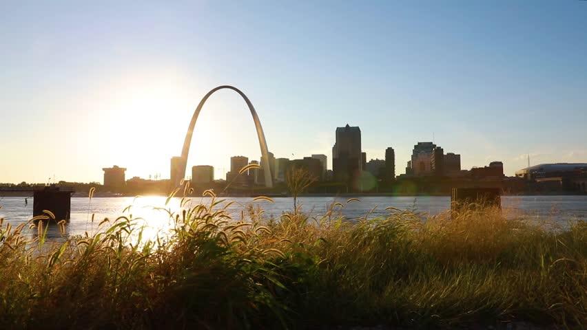 The St. Louis, Missouri skyline across the Mississippi River at dusk.