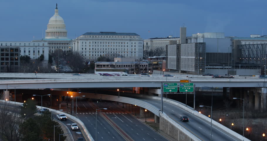 Washington D.C. Us Congress Building Cars Traffic on Crowded Highway Dusk in USA
