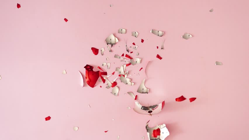 Slow motion of red Christmas bauble decoration falling and braking into pieces on pastel pink table. Minimal New Year party concept. | Shutterstock HD Video #1018057084