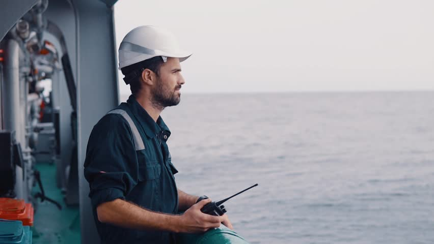 Marine Deck Officer or Chief mate on deck of vessel or ship . . Ship communication