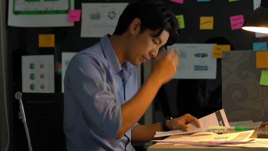 Businessman hard working with desktop computer to late night at office. Business people work overtime. Concept of salary man, fatigue and tired.   Shutterstock HD Video #1018092430