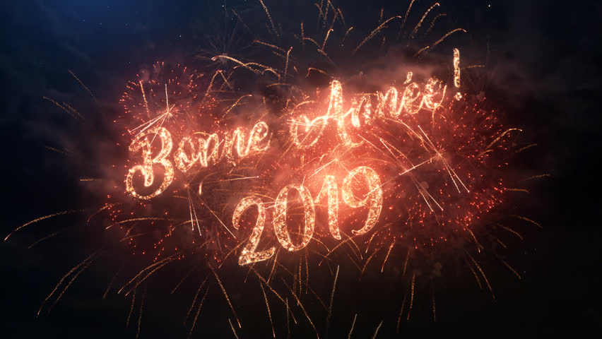 2019 Happy New Year greeting text in French with particles and sparks on black night sky with colored slow motion fireworks on background, beautiful typography magic design. | Shutterstock HD Video #1018126171