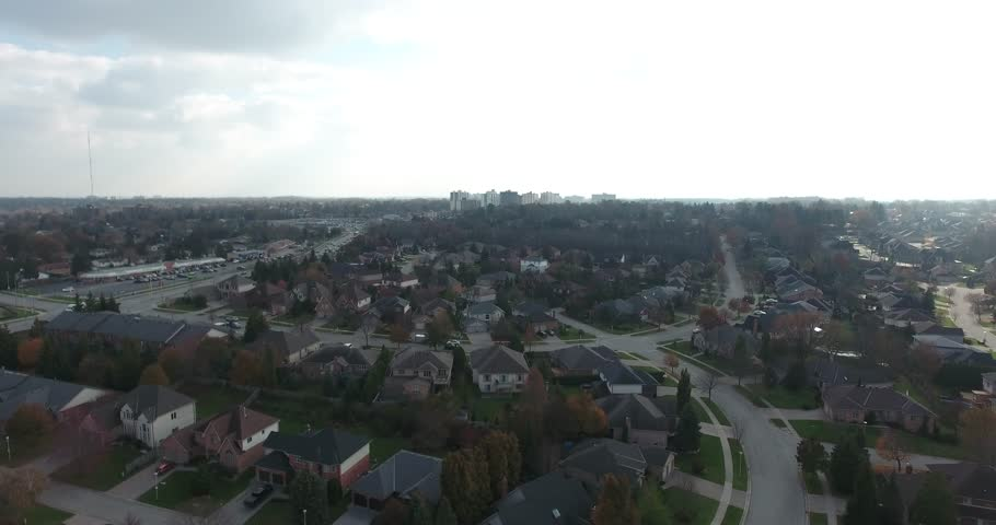 Distant City In Center Of Urban Neighborhood With Traffic On Road Aerial View