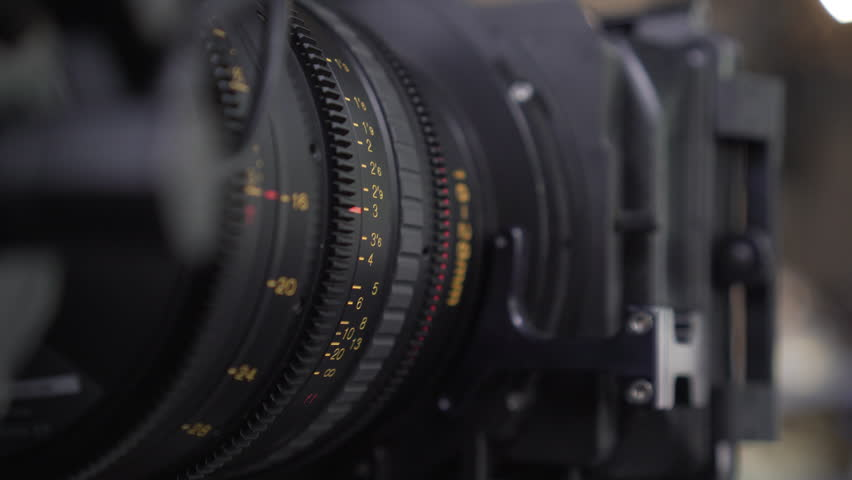 3 Clips Pack. Close up shot of man focusing the video camera. Camera operator working with a cinema broadcast TV camera