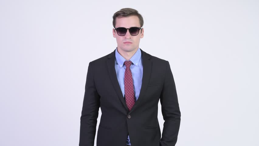 Young happy handsome businessman removing sunglasses and laughing | Shutterstock HD Video #1018140010
