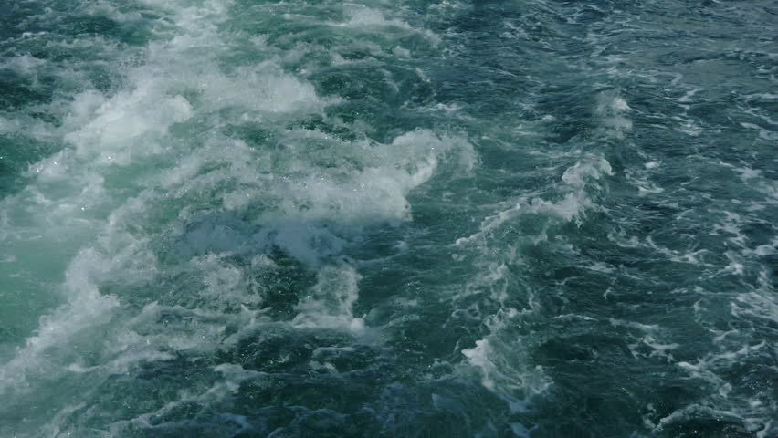 Sea waves in motion after the passage-boat, launch.  #1018143397