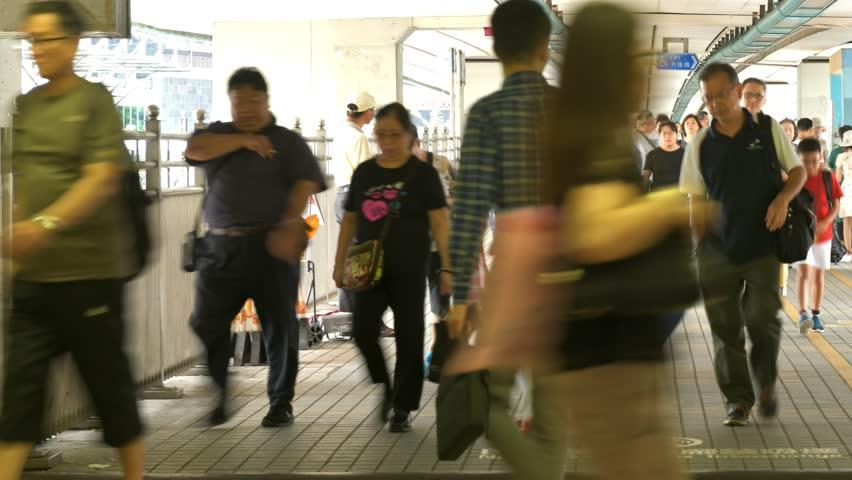 Timelapse of people moving along walk way in Hong Kong.   Shutterstock HD Video #1018164568